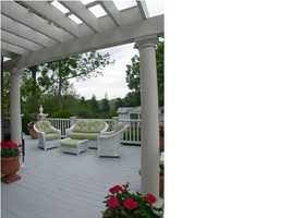 Outdoor porch to overlook the beautiful lake. Recently remodeled walk-out lower level is great for entertaining with a beautiful full bar and wine cellar