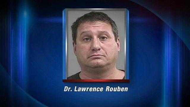 Police: Doctor arrested after pulling gun on utility worker