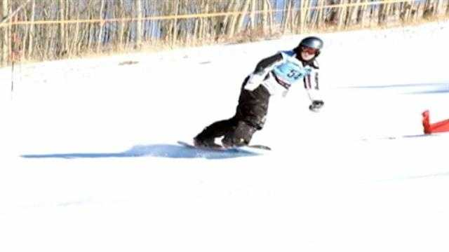 A teenager from Campbellsville, Ky., is defying the odds trying to make it big on the international snowboarding scene.