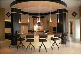An alternative view of the kitchen provides perspective on the kitchen's size, design and seating possibilities.
