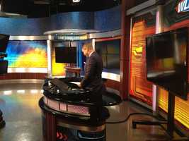 Eric getting ready to begin the noon newscast from the breaking news set