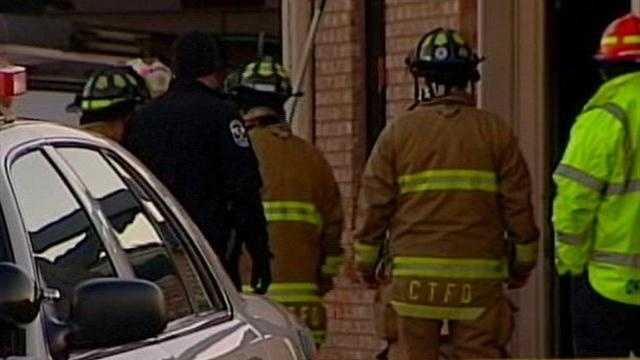 Crews are at the scene of a fire at a firearm repair shop.