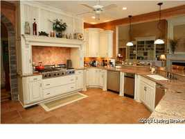 A side view of the kitchen shows how open and inviting this space truly is.