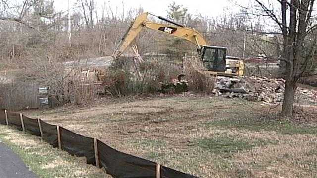 Crews started tearing down a Jefferson County home so they can begin building the East End Bridge.