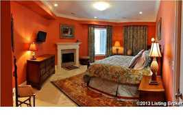 One of four bedrooms and it features a fireplace.
