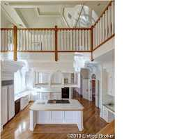 And your family/guests can look down over the kitchen from the second floor balcony.