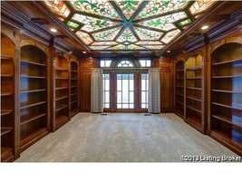 Stained glass ceiling covers this exquisite custom wardrobe.