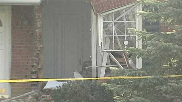A St. Matthews is safe after waking up to car in their living room