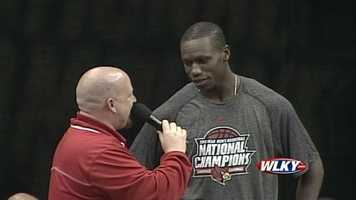 Gorgui Dieng addresses the fans at a Louisville basketball celebration Wednesday.
