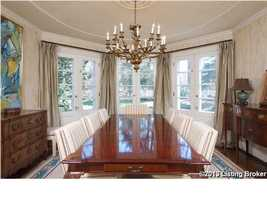 Formal dining room seats eight.