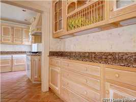 Stepping into the kitchen....plenty of cabinet space.