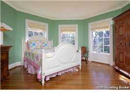One of the remaining 3 bedrooms in the home, features beautiful large windows.