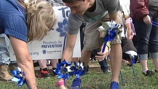 Students at Bullitt Central High School placed more than 200 pinwheels on campus Wednesday.