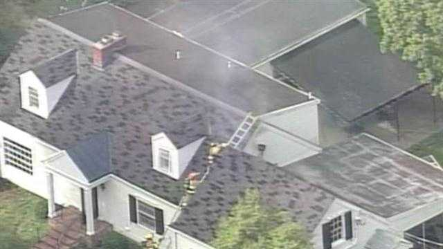 Firefighters are on the scene of a house fire in the Indian Hills neighborhood.