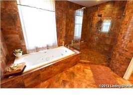 The tub is separated from the very large shower.