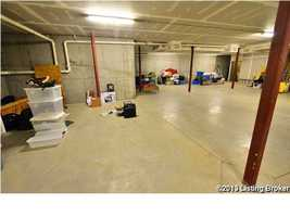 Expansive storage unit on the ground level for office supplies and home items.