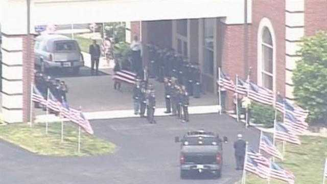 officer ellis body arrives at church.jpg