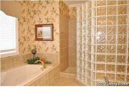 Large spa tub and separate shower.