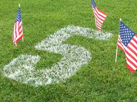 June 2, 2013: Before Ellis wore the police badge in Bardstown, he proudly wore the number 5 on Glen Este's baseball field. Sunday night the number was painted on the diamond as more than 100 people gathered in a memorial.