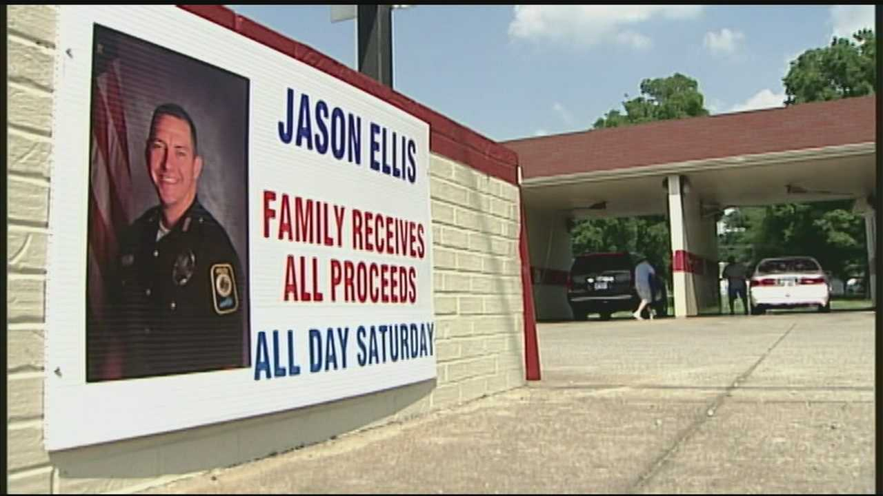 Family gathered at a car wash in Bardstown to give again to the family of a fallen hero.