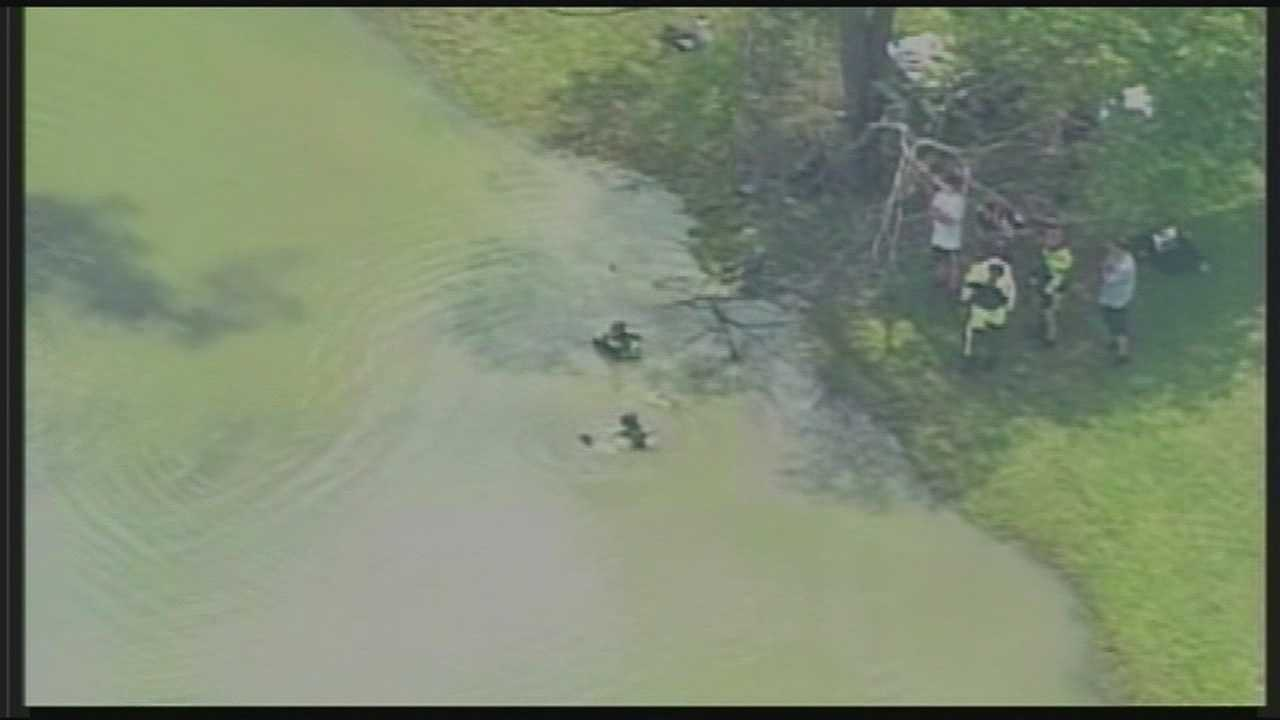 A dive team searched a pond near the site where Bardstown officer Jason Ellis was killed.