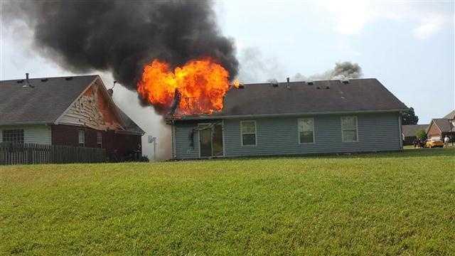 Raw video: Lightning strike sparks house fire