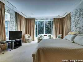 The gracious master bedroom appears both, luxurious and cozy.