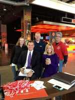 Producer Erin Gritton, photojournalists Mike Barnett and Dave Masino with Rick and Vicki at the UK-UL game in Dec. 2012.
