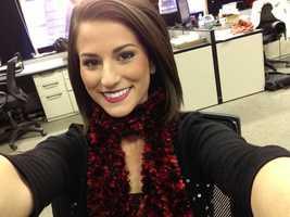 Reporter Erica Coghill selfies at her desk