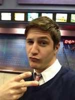 Reporter Tim Elliott does his best duck face selfie