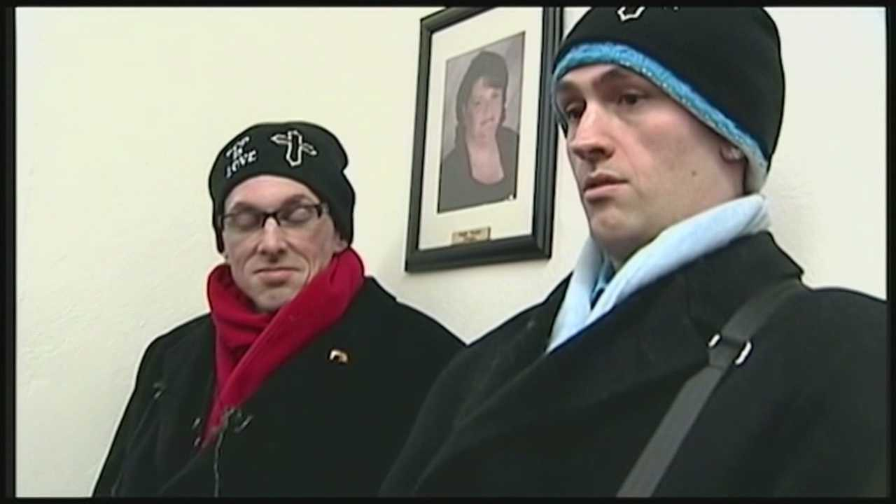 Gay couple found guilty of trespassing after sit-in