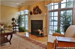 Living room boasts a beautiful fireplace.
