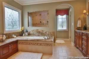 The master bath has a Whirlpool tub, granite stone tops, a bidet toilet seat with remote control, heated marble floor, including the decorative lighting by Schonbeck with Swarovski crystals!