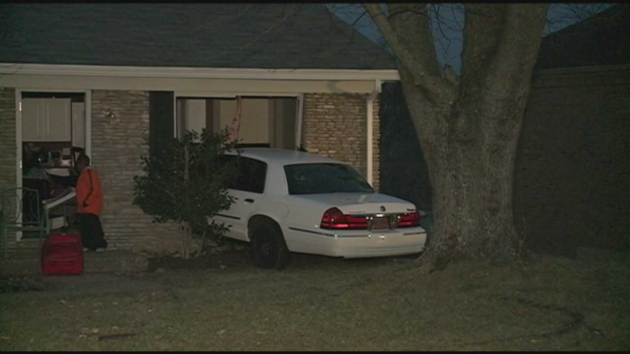 Louisville Metro Police arrest a man they say drove his car into his ex-girlfriend's home following a domestic dispute.