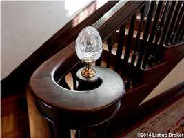 Elegant crystal ornament placed at the base of the staircase.