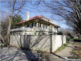 A wall encloses the 0.32 acre property. Please visit Realtor.com for more information on this property.