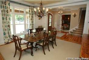 The formal dining room overlooks the front lawn and features traditional decor.