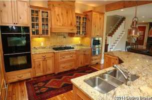 The spacious features custom cabinetry and gourmet appliances.