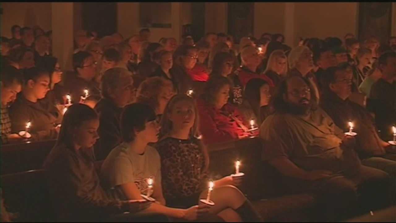 Vigil held for mother, children killed in fire