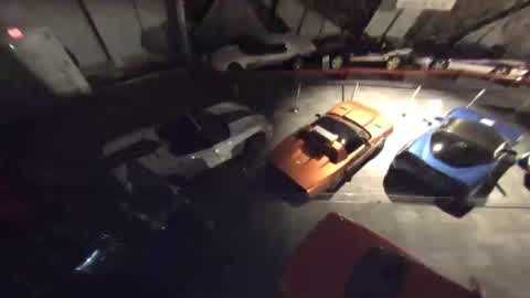 Security video released by the National Corvette Museum shows eight Corvettes falling into a sinkhole early Wednesday.