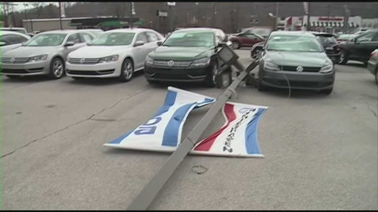 Wind knocks out sign at car Dixie Hwy dealership
