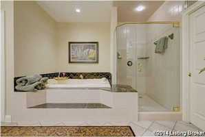 Separate shower and whirlpool tub.