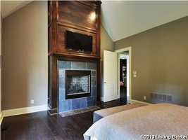 One of three beautiful stone fireplaces in the home.
