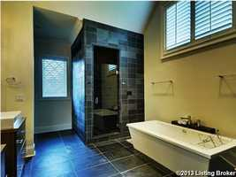 The master bath has slate floors and shower with gorgeous onyx wall.