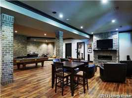 Soaring ceilings in the basement which includes an in-law suite and kitchenette.