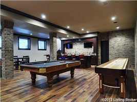 There's a pool table and plenty room for guests to socialize.