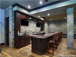The basement also includes a full bar.