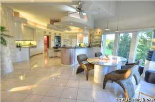 Breakfast area with custom designed table and matching granite top. Plus, you can enjoy lake views.