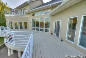 The deck is the full length of the home. However, the master suite also has a private balcony.
