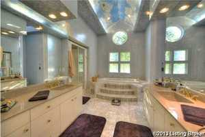 Master bathroom features a separate garden tub.